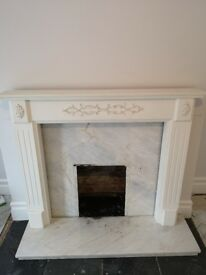 Fire surround with marble backing and hearth