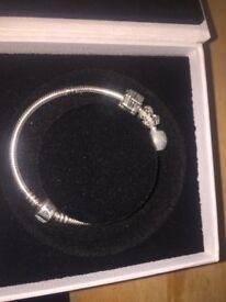 Pandora braclett never been worn 3 charms worth £160