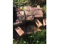 100 bricks and 11 concrete slabs