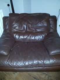 Brown two seater leather sofa and large armchair