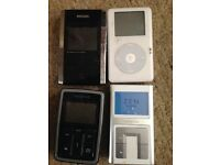 4 MP3 players some with boxes