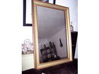 gold framed wooden mirror