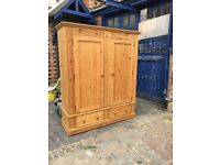 a large heavy solid pine wardrobe with 2 doors and 2 blanket drawers