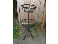 Outdoor metal plant stand.