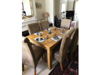 Wooden dining table with 6 suede chairs