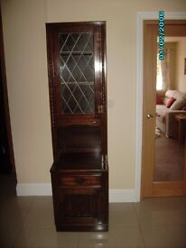 Dark wood dining room display cabinet and storage base with plate display grooves to each shelf
