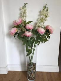 Artificial flowers with glass vase.