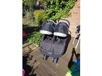 Baby Jogger City Mini Double Stroller in black. Includes rain cover