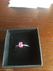 Sterling silver ring with pink Safire gem.