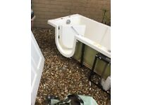 Disabled bath with easy entrance door.