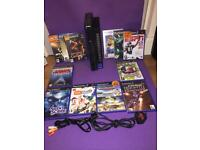 Playstation 2 console comes with 12 games, memory card and cables... missing controllers ...