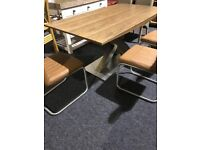 MODERN EXTENDABLE TABLE AND SIX BROWN LEATHER CHAIRS-few marks but unused