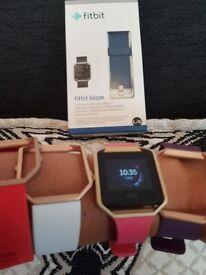 Fitbit Blaze with 5 straps.