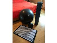 Swiss ball, medicine ball, rumble roller and acupressure body mat.