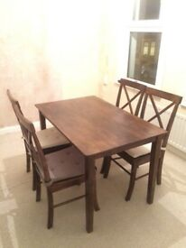 Table and chairs £150 ONO