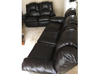 Black leather three and two seater recliner Sofas.