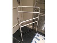 Free standing white towel hanger