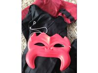 dracula cape and red devil mask
