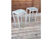 pair ofglass + metal side tables
