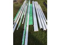Assorted white UPVC gutters, soffits, facias and trims