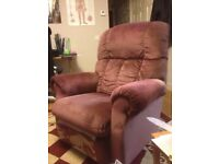 2 maroon recliner chairs