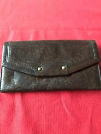 Brown leather purse.