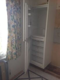 Integrated fridge and freezer.