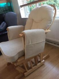 Gliding chair and foot stool, chair had 3 pockets for tv controllers, book etc.