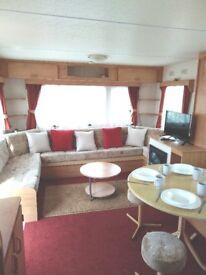 Only £99 for short breaks - 3 bed caravan Lyons Robin Hood near Prestatyn