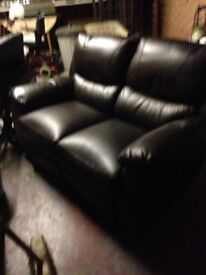 Brown 2 seater sofa used