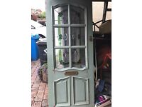 Solid wooden front door with leaded stained glass