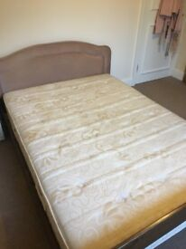 Double bed frame with head rest and mattress