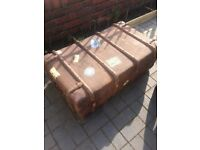 Old vintage leather and canvas trunk