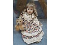 Collectible dolls - porcelain faces. With stands.