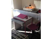 White / off white and pink desk with computer swivel chair