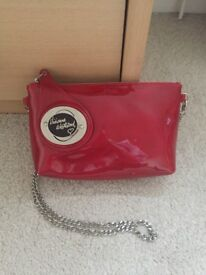 Brand new never used Vivienne Westwood red clutch bag with silver strap