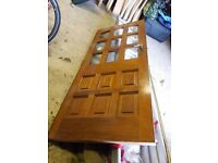 An old internal solid wood door with glass panes.