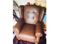 Brown leather winged chair
