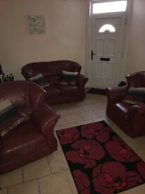 2 seater sofa and 2 chairs , leather , red in good condition