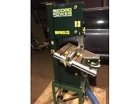 Bandsaw with fully adjustable table and dust extraction pipes