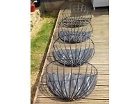 Set of 4 Hay rack / garden wall planters, solid metal with plastic coating £20 the lot. All in VGC