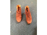 Brown wedged boots in great condition!
