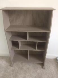 Grey book shelf storage unit