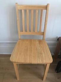 2 light wood chairs