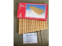 Wooden xylophone with music sheet
