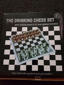 Shot chess. Drinking game. Board game. Glasses.