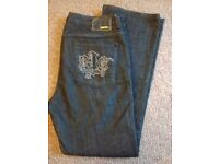 Woman's dark blue River island jeans, size 16, boot cut, in lovely condition