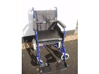 Little used travel wheelchair with lined cover in as new condition £50