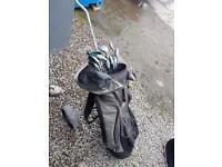 Golf clubs , golf trolley and golf bag