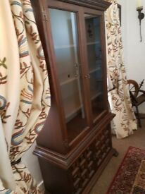 dark wood display cabinet glass fronted